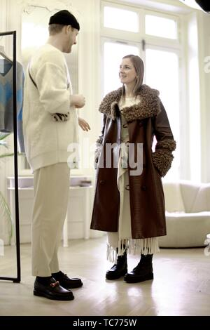 (not model released!) fashionable woman talking with designer in private showroom, in Paris, France. - Stock Photo