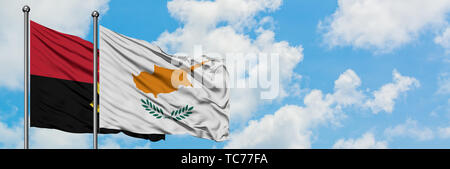 Angola and Cyprus flag waving in the wind against white cloudy blue sky together. Diplomacy concept, international relations. - Stock Photo