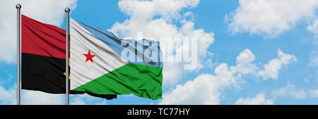 Angola and Djibouti flag waving in the wind against white cloudy blue sky together. Diplomacy concept, international relations. - Stock Photo