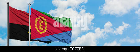 Angola and Eritrea flag waving in the wind against white cloudy blue sky together. Diplomacy concept, international relations. - Stock Photo