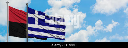 Angola and Greece flag waving in the wind against white cloudy blue sky together. Diplomacy concept, international relations. - Stock Photo