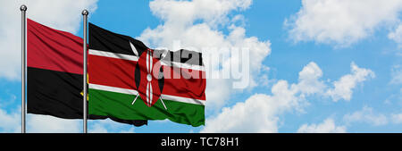 Angola and Kenya flag waving in the wind against white cloudy blue sky together. Diplomacy concept, international relations. - Stock Photo