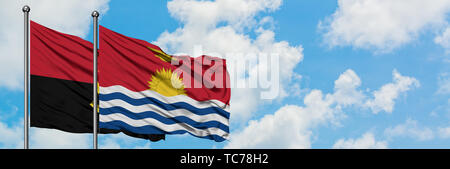 Angola and Kiribati flag waving in the wind against white cloudy blue sky together. Diplomacy concept, international relations. - Stock Photo