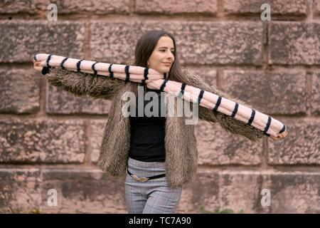 content woman playing with scarf, in Munich, Germany - Stock Photo
