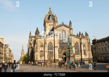 Royal Mile with the statue of Walter Francis Montagu Scott and view of Saint Giles Cathedral, or High Kirk of Edinburgh, Gothic style, XII century, - Stock Photo