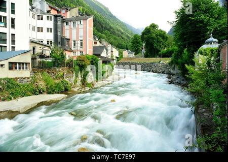 The Gave (stream mountain) de Cauterets go through the town. Cauterets town, Hautes-Pyrénées department, Occitanie region, France. - Stock Photo