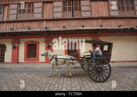 Kalesa horse carriage on historic Calle Crisologo, Vigan, Ilocos Sur, Philippines. - Stock Photo