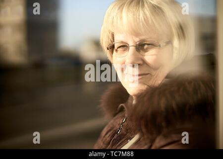 portrait of content senior woman in city, in Cottbus, Brandenburg, Germany. - Stock Photo