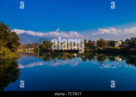 The Annapurna Massif (range) of the Himalayas, which includes Annapurna 1, the tenth highest peak in the world and in center, Fishtail (Machpuchare) - Stock Photo