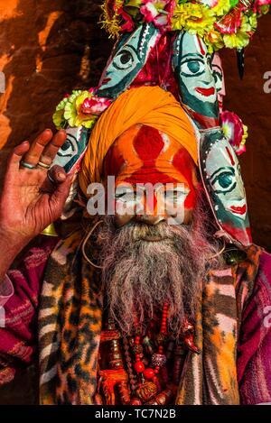 A sadhu (Holy man) at the Pashupatinath Temple, a Hindu temple along the Bagmati River in Kathmandu, Nepal. The Bagmati is equally as sacred to - Stock Photo