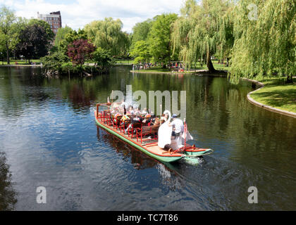 Lagoon with Swan boat and in Boston Public Garden adjacent to Boston Common, part of the Emerald Necklace group of parks by Frederick Law Olmstead