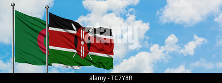 Algeria and Kenya flag waving in the wind against white cloudy blue sky together. Diplomacy concept, international relations. - Stock Photo