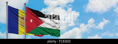 Andorra and Jordan flag waving in the wind against white cloudy blue sky together. Diplomacy concept, international relations. - Stock Photo