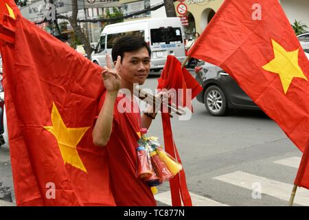 Man seling Vietnamese flags in Ho Chi Minh City,Vietnam,South East Asia. - Stock Photo