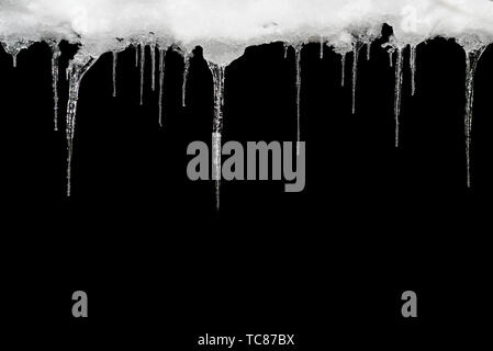 Icicle, isolated on a black background, template for design. - Stock Photo