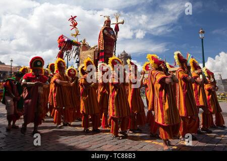 Indigenous people with traditional costumes during a performance representing the Inca King's parade at the Inti Raymi Festival in Plaza De Armas, - Stock Photo