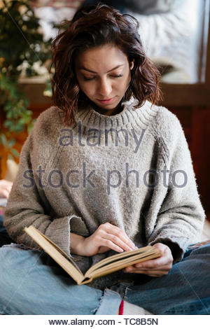 Serene woman reading book - Stock Photo