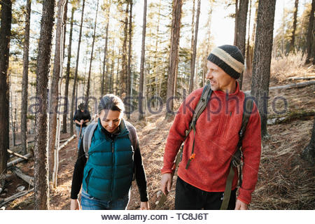 Couple hiking in woods - Stock Photo