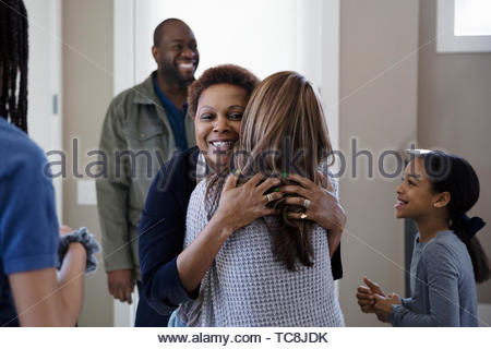 Happy family greeting grandparents - Stock Photo