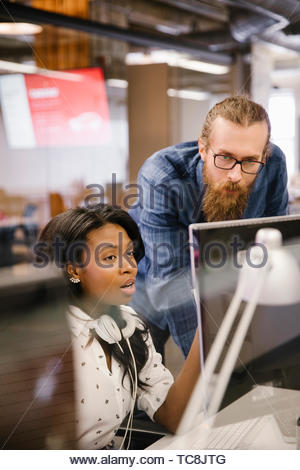 Business people meeting at computer in office - Stock Photo