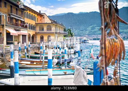 Monte Isola, Peschiera Maraglio town  with fisherman boats - Stock Photo