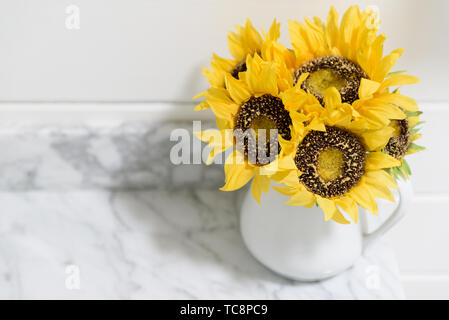 sunflowers in vase on marble - Stock Photo