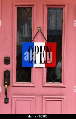 Open sign hanging on entrance of french restaurant, Yanaka, Ueno, Tokyo, Japan, Asia. - Stock Photo