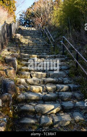 Stone steps with iron railing going up, part of the old Nakasendo road, Magome, Japan, Asia. - Stock Photo