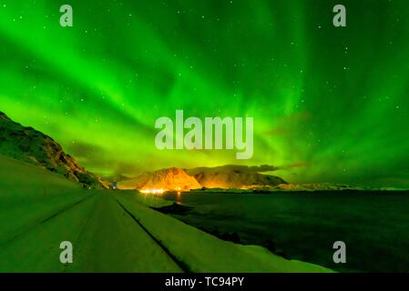 Northern Lights (Aurora Borealis) seen from along the E10 near Reine, Moskenoesoya Island, Lofoten Islands, Arctic, Northern Norway. - Stock Photo