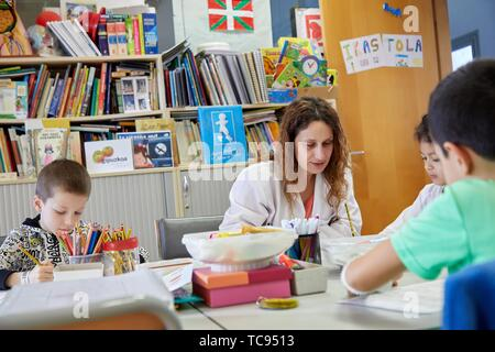 Teacher with children in a classroom of studies and games, Plant for hospitalization of children, Pediatrics, Medical care, Hospital Donostia, San - Stock Photo