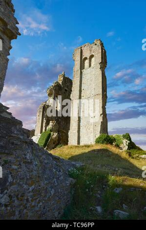 Medieval Corfe castle keep close up sunrise, built in 1086 by William the Conqueror, Dorset England. - Stock Photo