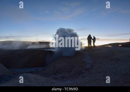 Sol de Mañana geysers steaming at dawn, Salar de Uyuni, Bolivia. - Stock Photo