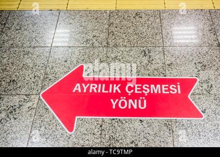 Signboard on the ground shows direction of Ayrilik Cesmesi train station stop,Istanbul,Turkey. - Stock Photo