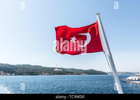 Turkish flag and Dur Yolcu memorial on background in Kilitbahir District,Canakkale,Turkey. - Stock Photo