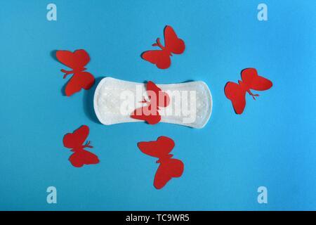 Sanitary napkin for menstruation on blue background. - Stock Photo