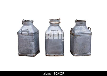 Old milk churns isolated on white. - Stock Photo