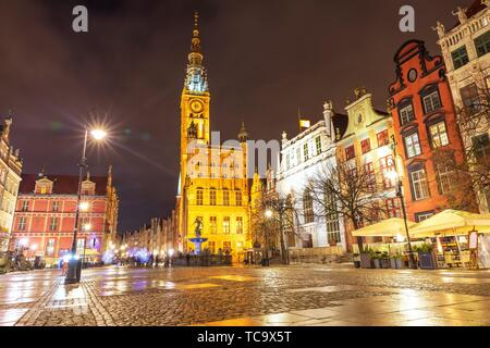 Gdansk Town Hall and the Fountain of Neptune in Long market, evening view. - Stock Photo