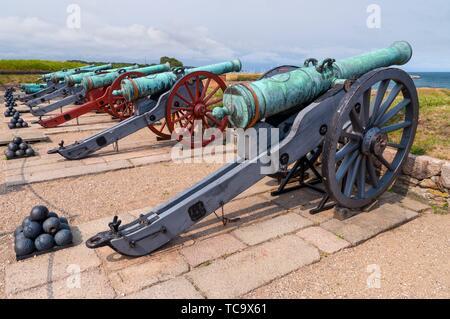 Ancient battle cannons in Kronborg castle, Denmark. - Stock Photo