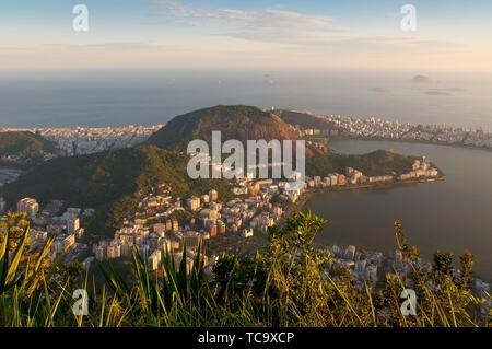 A photo of a sunset over the Lagoa Rodrigo de Freitas in Rio de Janeiro, Brazil. View from Corcovado is spectacular and shows Rio's amazing, wondrous - Stock Photo