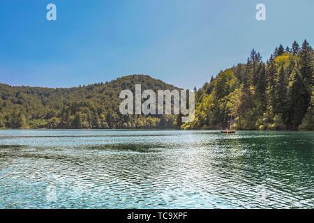 Lika-Senj County, Karlovac County, Croatia - 2013: Tourist taking a boat ride on the lakes in Plitvice Lakes National Park. - Stock Photo