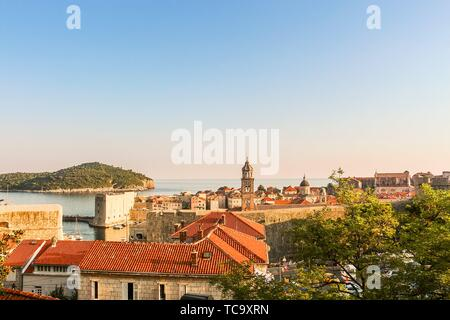 Rooftop view of the Old Town of Dubrovnik and Lokrum island in the distance. - Stock Photo