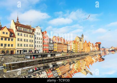 Gdansk promenade by the Motlawa river in the sunshine. - Stock Photo