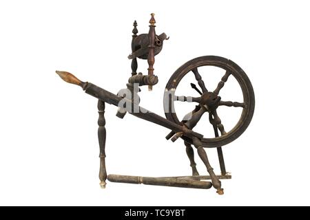 Spinning Wheel For Making Yarn From Wool Fibers. Vintage Rustic Equipment. - Stock Photo