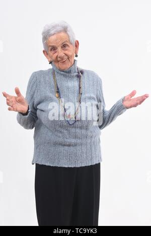 senior woman with open hands on white background. - Stock Photo
