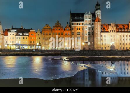 Mariacka Gate and other sights of Gdansk on the bank of the Motlawa, evening view. - Stock Photo