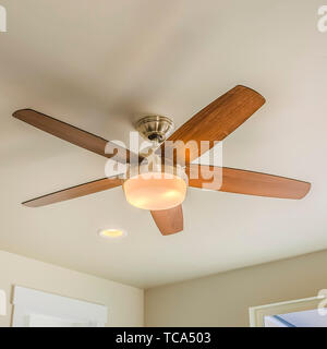 Frame Square Ceiling fan with wooden five blade design and built in light - Stock Photo