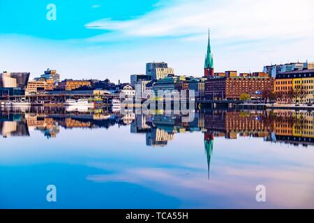 Reflection of the Old Town of Stockholm in the water. - Stock Photo