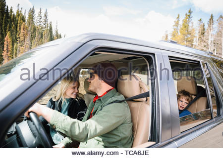 Family on road trip in SUV - Stock Photo