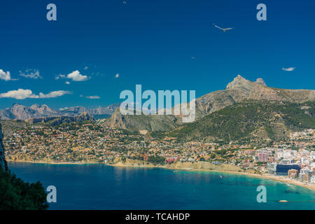 View of the residential area and some hotels in Calpe with the Aitana mountain range at background from the top of the rock of Ifach - Stock Photo
