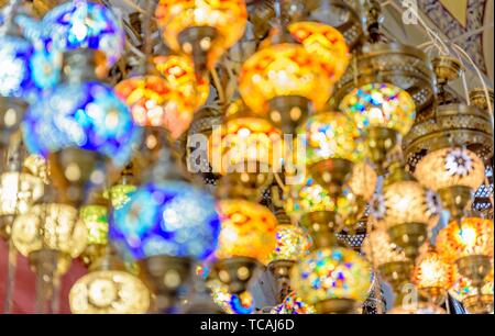 Blurred Traditional colorful handmade Turkish lamps and lanterns hanging in souvenir shop for sale. - Stock Photo